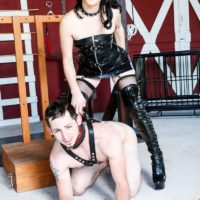 Dark-haired chick Sarah Dice dominates her man slave in latex attire and lengthy boots