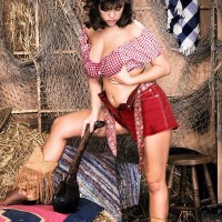Brunette farm female Carrie sets her large boobies free in leather boots and cut-offs