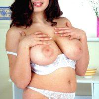 Dark-haired model Kerry Marie loosing her huge porno starlet boobies from lingerie
