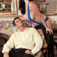 Black-haired MILF Shione Cooper showing off humungous boobs for nip gobbling in stockings