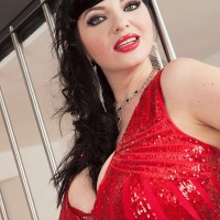 Dark haired model Joana Blessing sets her great breasts free of a short red sundress in crimson high-heels