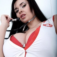 Dark-haired nurse Sha Rizel removes her uniform to pose in her boulder-holder and panties