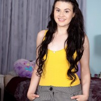 Dark-haired teenager girl Danielle unsheathes her little boobies for the highly first time