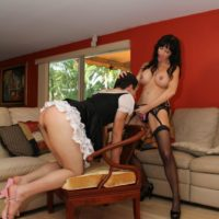 Black-haired mistress Angie Noir face porks her sissy with a monster-sized strapon pecker in high heeled shoes