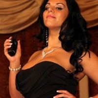 Brown-haired mistress Bella Reese makes her masculine submissive eat out her sphincter in high-heeled shoes