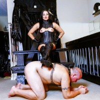 Dark-haired woman Michelle Lacy dominates her subby husband slave in thigh highs