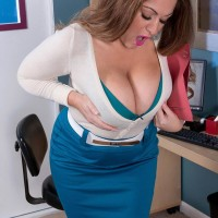 Dirty light-haired MILF Janessa Loren letting fun bags loose from melon-holder in home office place
