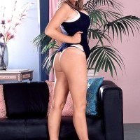 Horny sandy-haired MILF Kelly Kay showcases upskirt panties and her bum cheeks