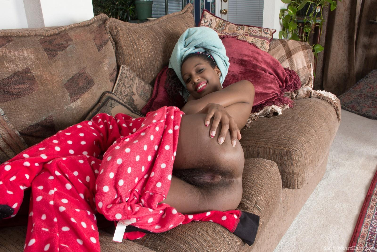 Ebony first-timer with petite floppy tits revealing hairy ebony twat on couch