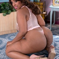 Ebony BIG SEXY WOMAN Layla Monroe flaunts her enormous booty in see thru dress and thong underwear