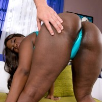 Ebony BIG SEXY LADY Stacy Love has her monster-sized ass massaged in a onesie and high-heels