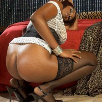 Black MILF Leah Ray flaunts her immense butt during solo activity in tights and high-heels