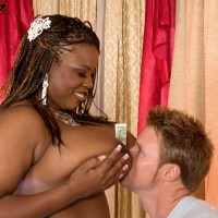 Ebony stripper Mianna Thomas uncovers her massive knockers in tights and garters