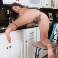 Euro amateur Katie Z demonstrating hairy armpits and natural pubic hair in kitchen