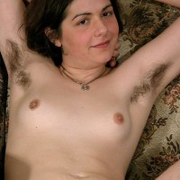 European amateur with pierced erect nips showing off hairy armpits and gash
