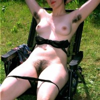 Euro dark-haired amateurs display fur covered pits and pussies in the backyard