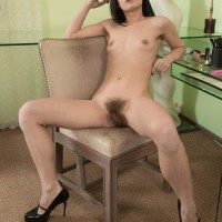 European dark-haired Gerda May baring lil' funbags and wooly cunt in stilettos