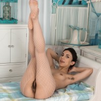 European dark-haired Luna demonstrating fur covered armpits and snatch in ballerina clothing