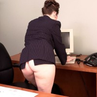 European MILF adult film star Desirae displaying big upskirt booty in office place outfitted high heels