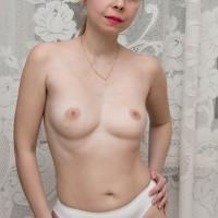 Euro babe with smallish fun bags gliding panties aside to reveal furry vagina