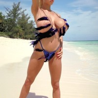 Famous light-haired X-rated star Tiffany Towers demonstrating hooters outdoors on beach