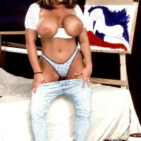 Prominent MILF pornstar Tawny Peaks loosing monster tits outfitted faded denim jeans