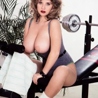 Well-known older pornographic starlet Tracy West uncorks her ultra-cute boobs on home gym equipment