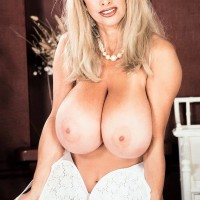 Well-known porno starlet Alexis Love uncups her giant funbags in milky hosiery and crimson stilettos