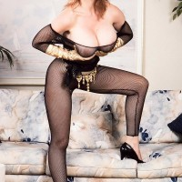 Famous adult flick star Ashley Splatter sheds her gigantic boobies from crotchless bodystocking