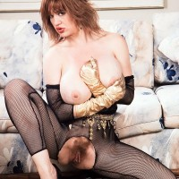 Well known XXX vid starlet Ashley Squirt sheds her large titties from crotchless bodystocking