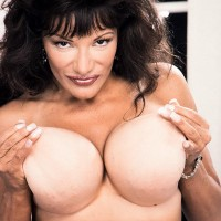 Well known pornostar Big-chested BriAnna plays with her erect nipples while showing her massive boobs