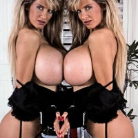 Famous porno starlet Buxom Dusty presses her gigantic boobs up against a mirror