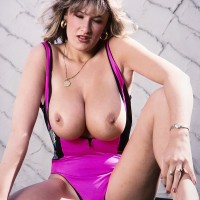 Well-known XXX pornstar Debbie Q sets her superb boobies free of a taut sundress in solo action