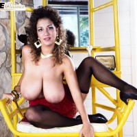 Famous adult vid starlet Devon Daniels flaunts her enormous funbags garbed ebony stockings