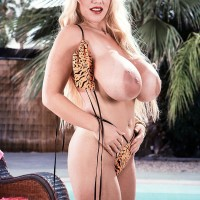 Legendary adult video starlet Honey Moons unleashes her big juggs from her swimsuit top