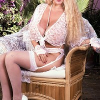 Well-known adult movie starlet Honey Moons releases her humungous tits outdoors in garters and tights