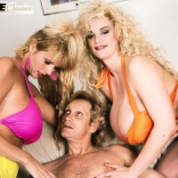 Well known XXX adult star Kimberly Kupps and wife bare big hooters while sharing a rigid wood