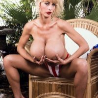 Prominent XXX adult starlet Pandora Peaks looses her immense breasts from a USA themed swimsuit