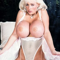 Notorious adult flick star Platinum Peaks holds her chubby breasts in a milky jumper