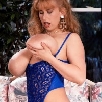 Prominent X-rated actress Tabatha Towers plays with her big funbags in white pantyhose
