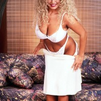 Notorious X-rated film starlet Taylor Marie whips out her immense breasts in a white sundress and lingerie