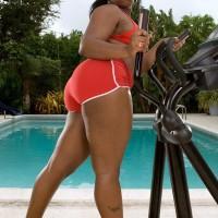 Plus sized ebony girl Keyona Kay oiling up beautiful huge ass outdoors by swimming pool