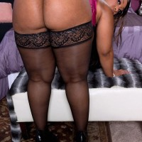 Fat ebony solo female Virgin Blossoms showing off immense ass in nylons and lingerie