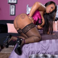 Over weight ebony solo chick Virgin Blossoms flashing immense butt in hosiery and lingerie
