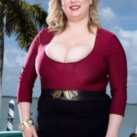 Overweight blonde girl Laddie Lynn flashes her upskirt undies along with her ample bosom