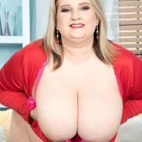 Plus sized blond chick Porsche Dali unveil her humungous boobs as she strips to her rosy panties