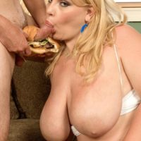 Obese golden-haired chick Scarlett Rouge licking food while engaging in blow job activities