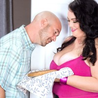 Plus-size dark-haired mistress Charlotte Angel enjoys some food before her screw sessions