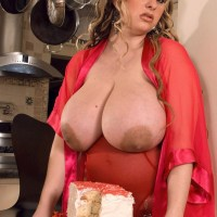 Plus-sized girl April McKenzie touting giant tits while slurping dick and munching food