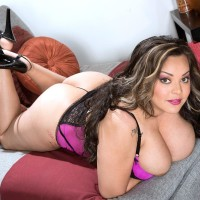 Plus-size solo model Cat Bangles letting her immense knockers slip free from bra in high-heels